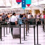 Travellers queuing at an airport